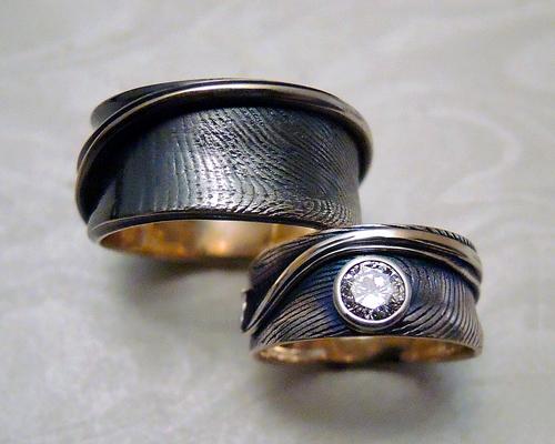 Engagement, wedding bands with fingerprints.