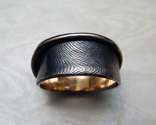 Fingerprint wedding band 10mm wide.