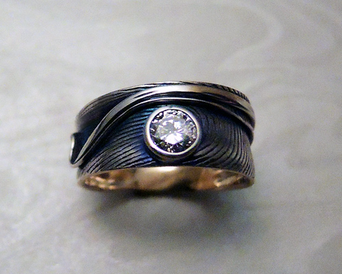 Fingerprint engagement ring 8mm wide with 1/4ct diamond.