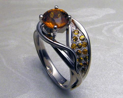 asymmetrical_engagement_ring_with_orange_sapphires_2.jpg