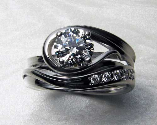 Very unusual, unique engagement ring with matching wedding band.