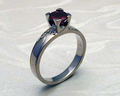 Art Deco engagement ring, ruby with pave diamonds.