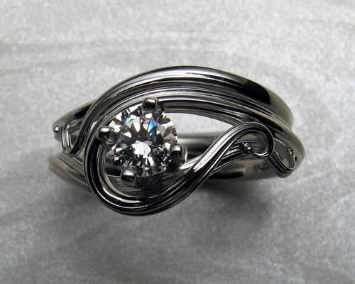 Free form, art nouveau style engagement ring set.