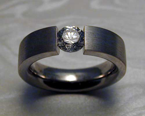 Tension set diamond engagement ring.