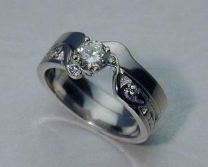 Interlocking engagement ring, wedding band set.