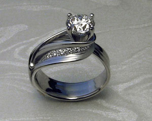 Custom made, ribbon-like, engagement ring.