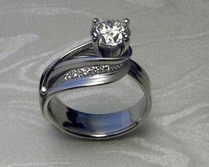 Custom made, ribbon-like, engagement ring.