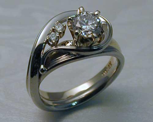 Unique handcrafted engagement ring enhancer set.