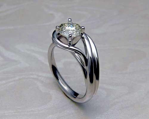 Beautiful asymmetrical engagement ring.