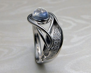 Contemporary, Art Nouveau style engagement ring.