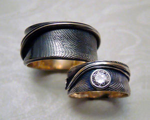 Engagement, wedding bands with fingerprints.