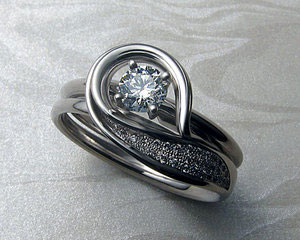 Solitaire engagement ring with very unusual band.