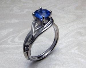 Wave-like, fluid engagement ring.