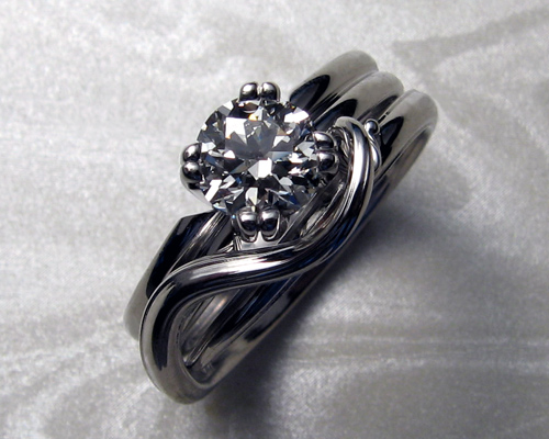 Solitaire engagement ring with split band.