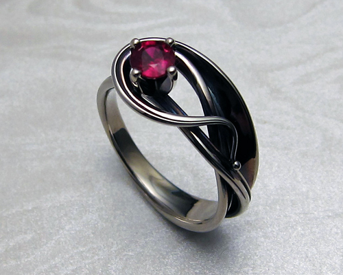 Contemporary Art-Nouveau style engagement ring, with ruby.