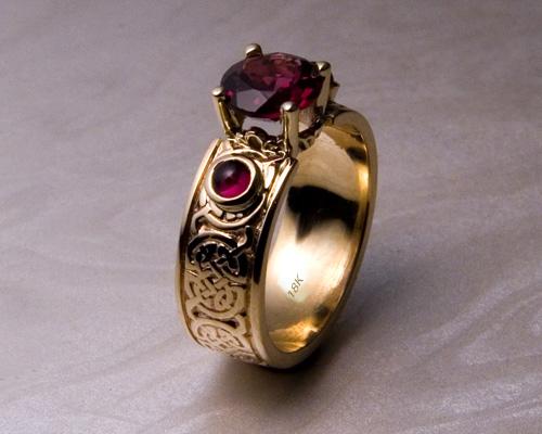 Celtic knot-work garnet engagement ring.