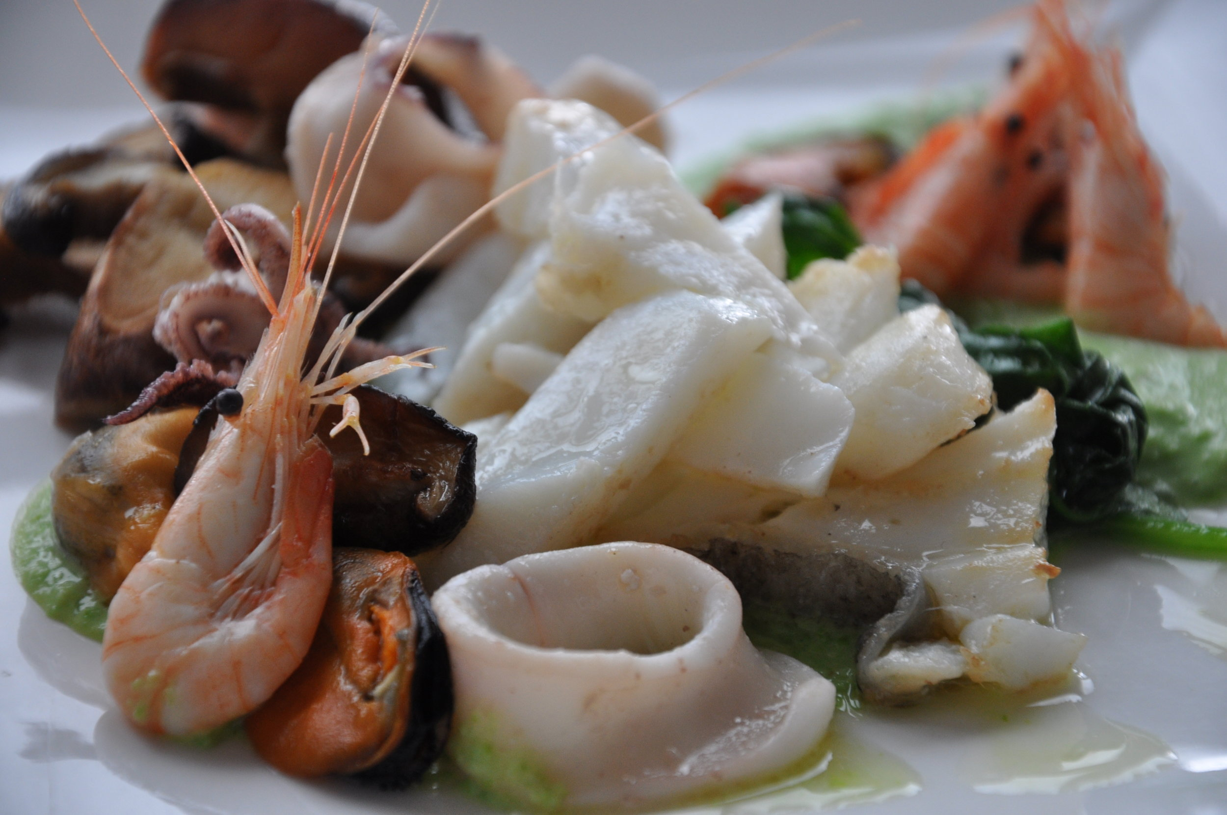 Mixed Seafood Plate with cod, shrimp, calamari and mushrooms - available on Shutterstock