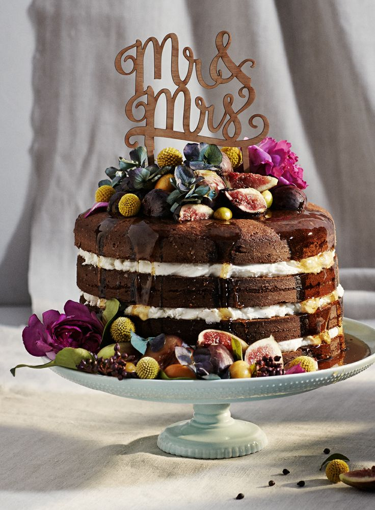 The naked cake is all the rage right now and I'm drooling over this one!  Fabulous cake stand by  BHLDN
