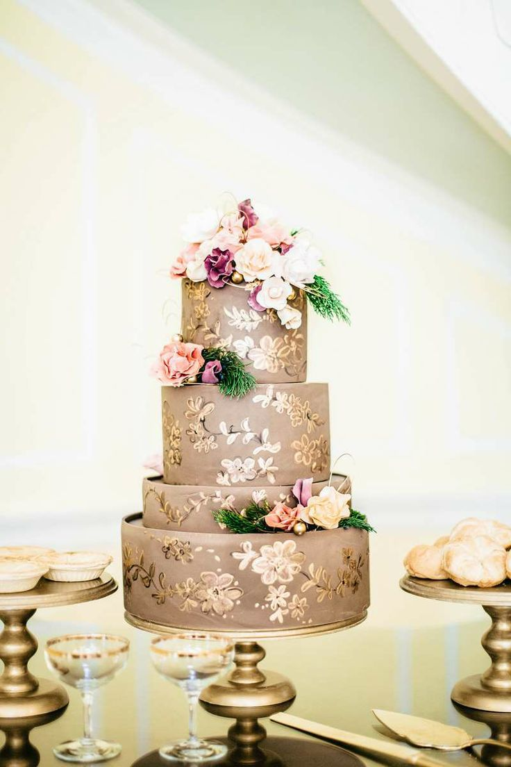 Beautiful hand painted gold and chocolate cake by  Sky's the Limit Custom Cakes and More , Styling by  Ooh!  Events