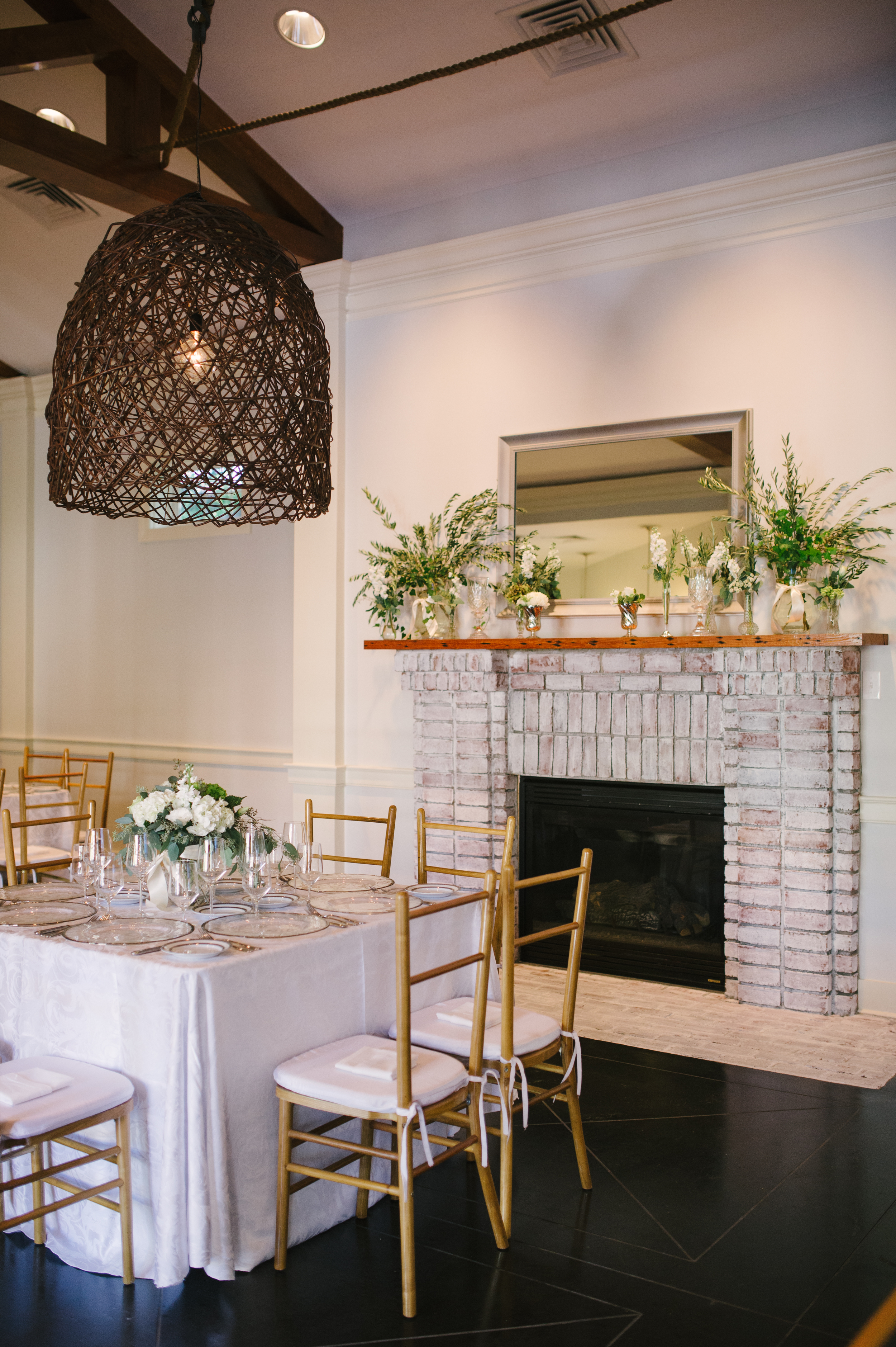 {I love this table and chairs by Snyder.  The fabulous light fixture was added for this event by Technical Event Company}