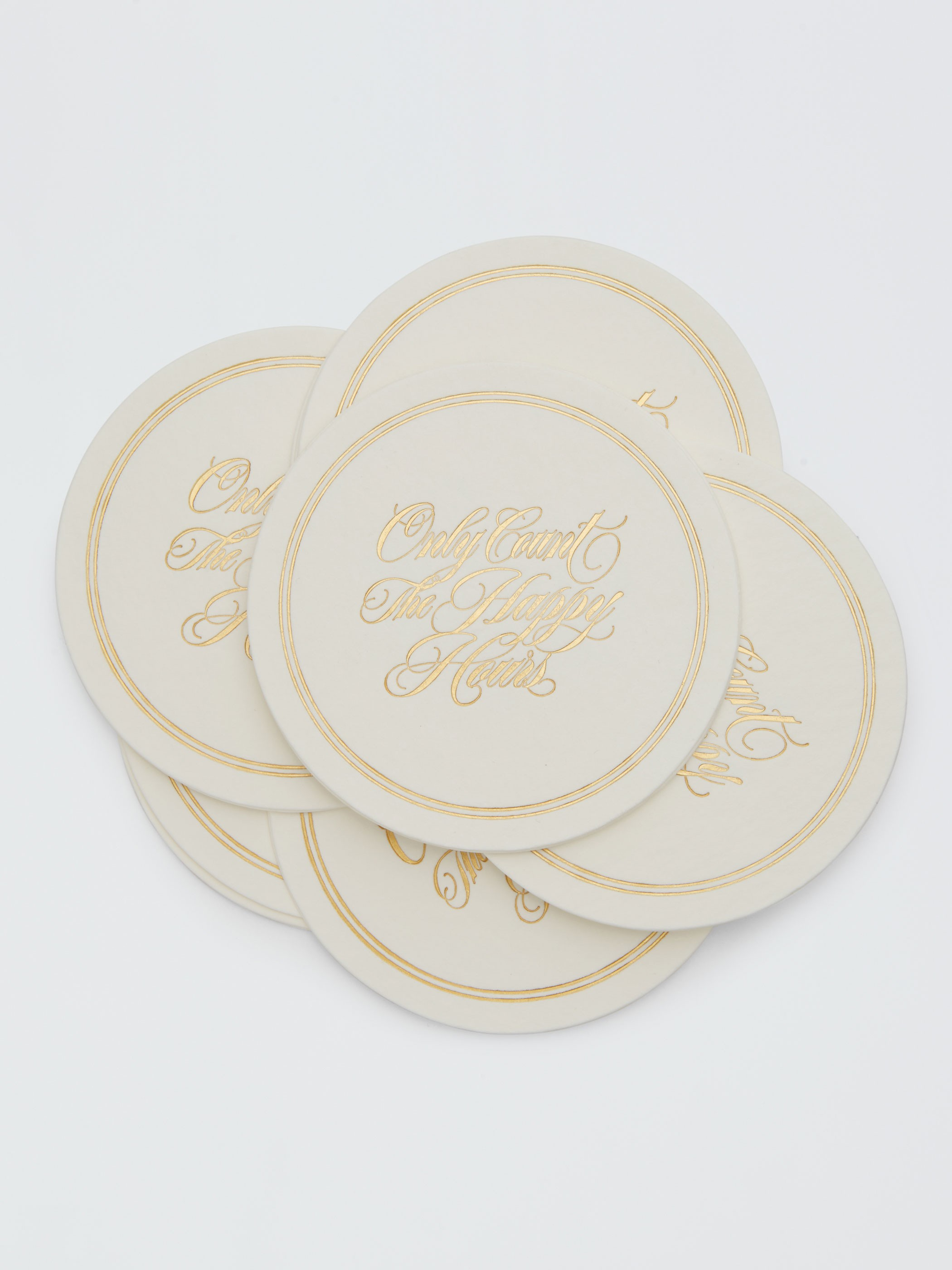 "Charming ""Only Count the Happy Hours""  Set of 12 paper coasters . Designed by Kentucky-based graphic designer Hanna Seabrook and produced in Raleigh, NC."
