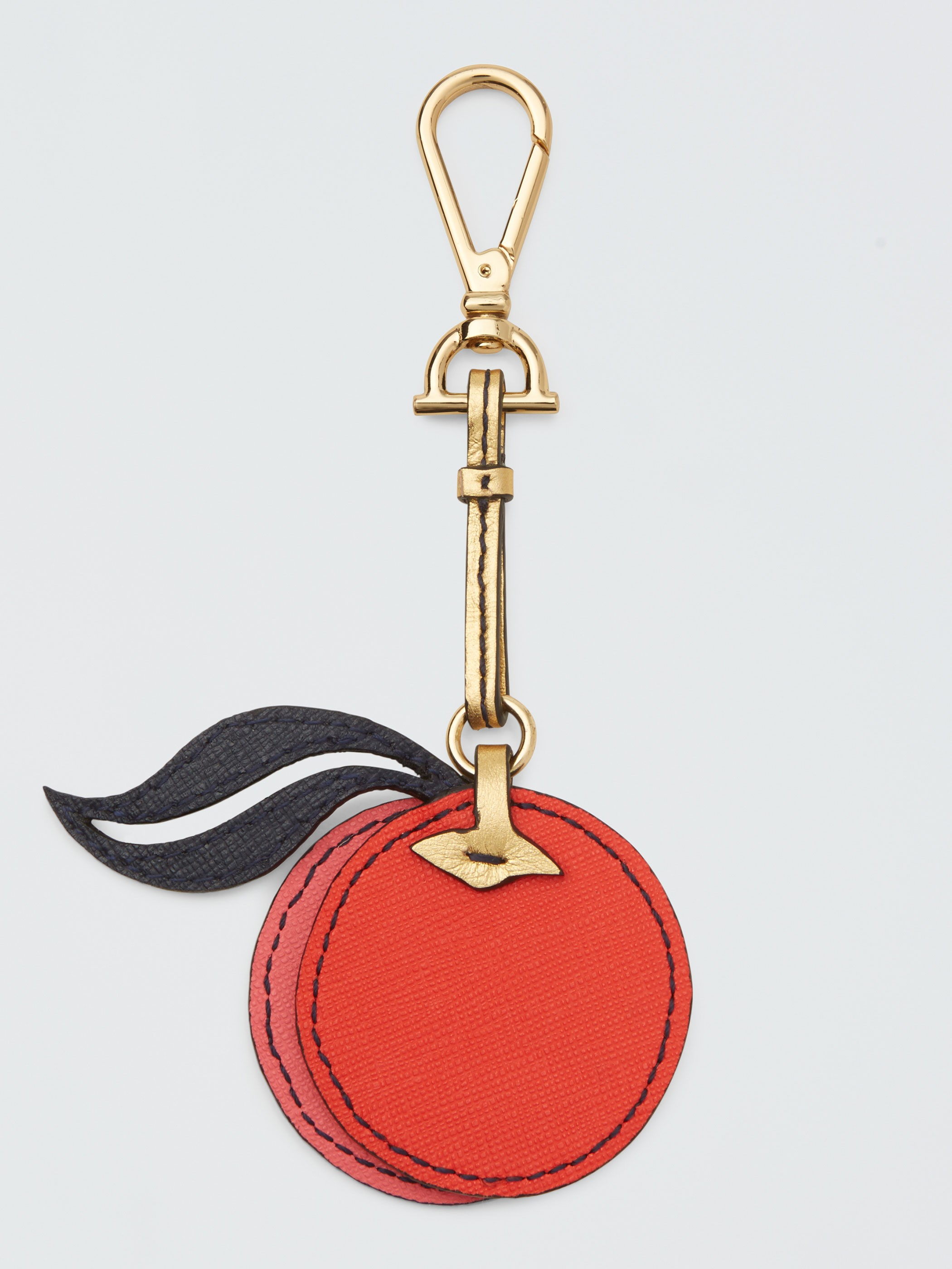 Peach Key Fob  - Made from Saffiano leather and stunning gold hardware in the shape of a horse bit! There are a few adorable options on the website!