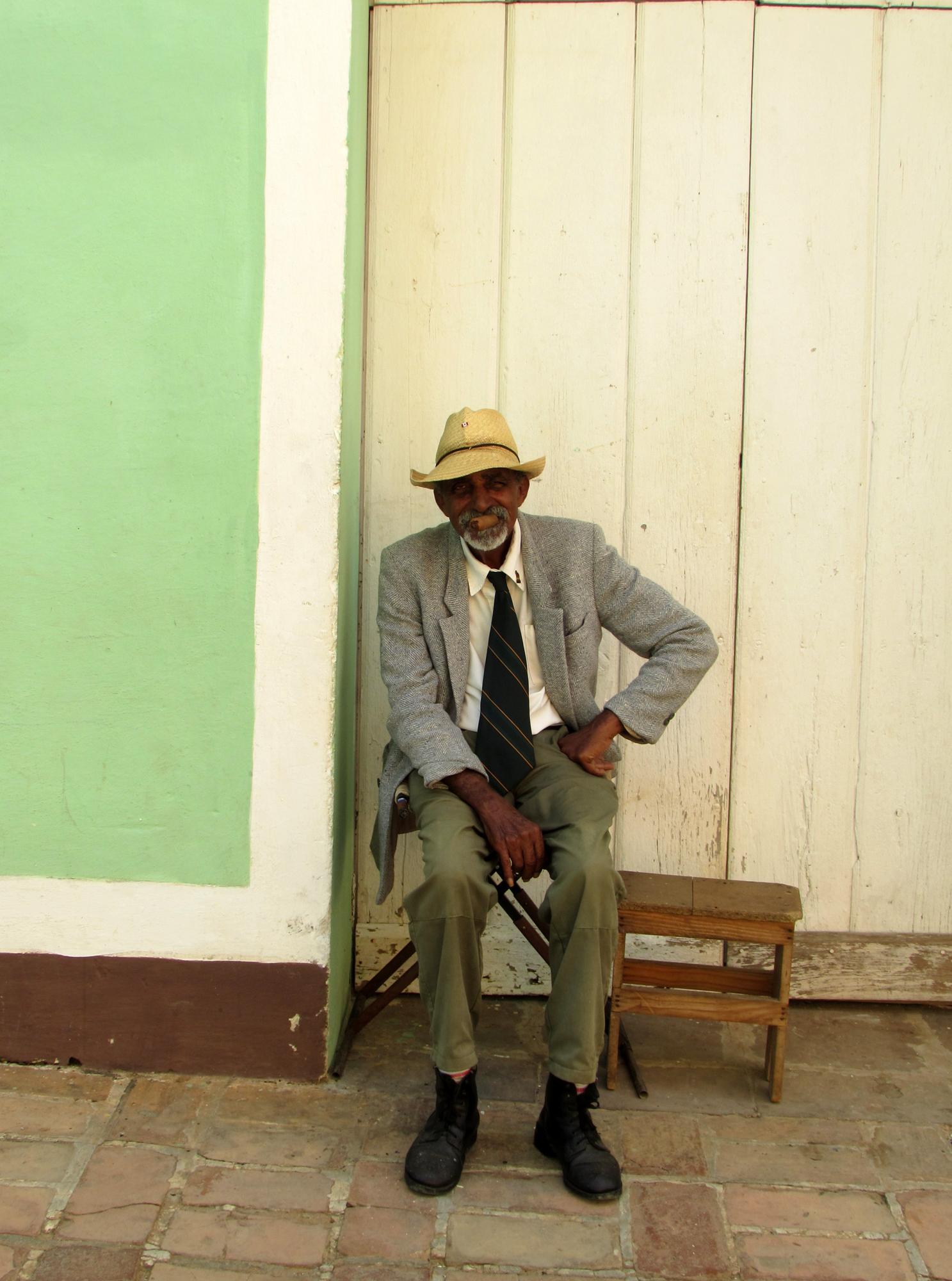 A kind local smoking his cigar