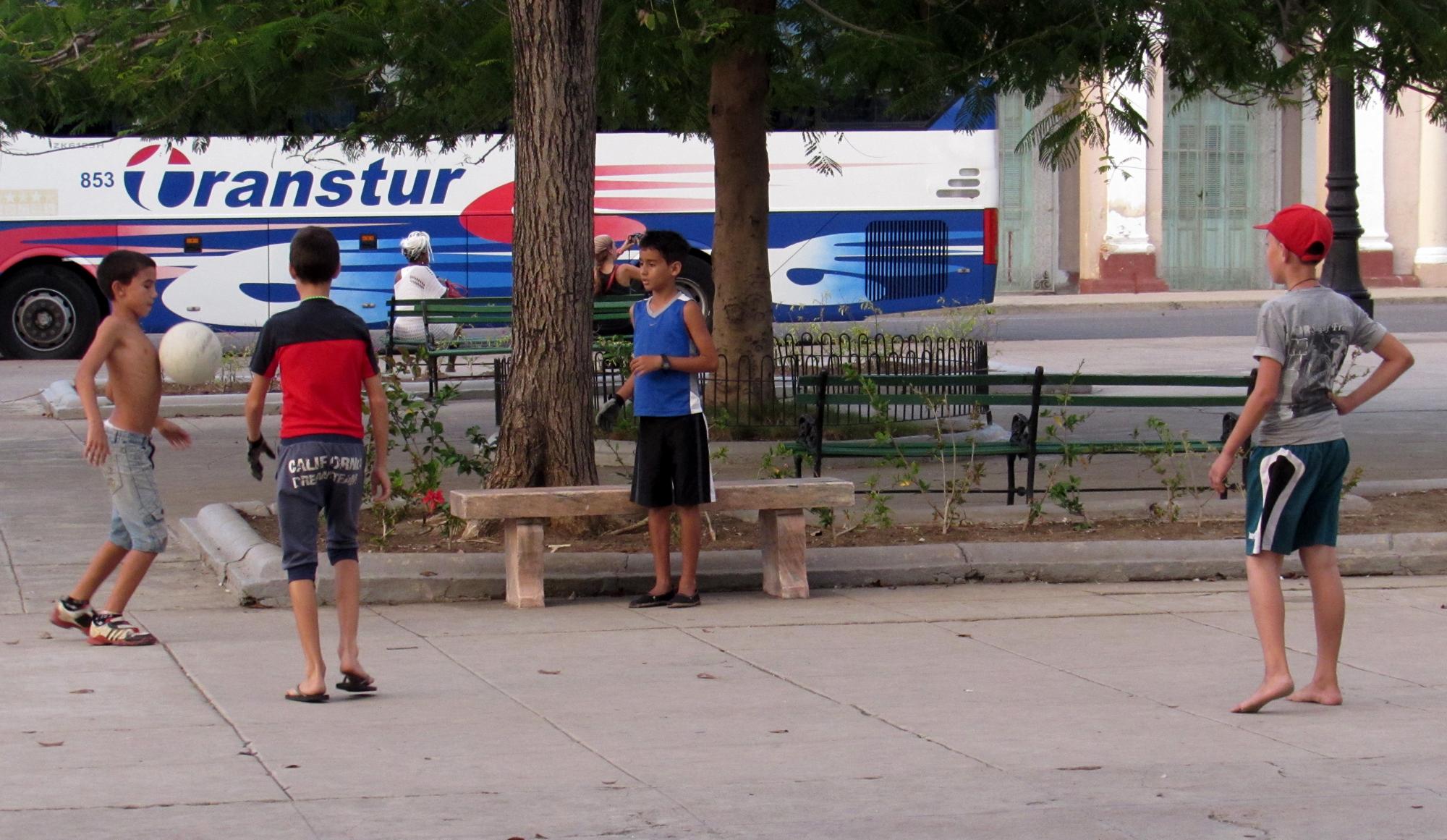 Children playing futbol in Cienfuegos