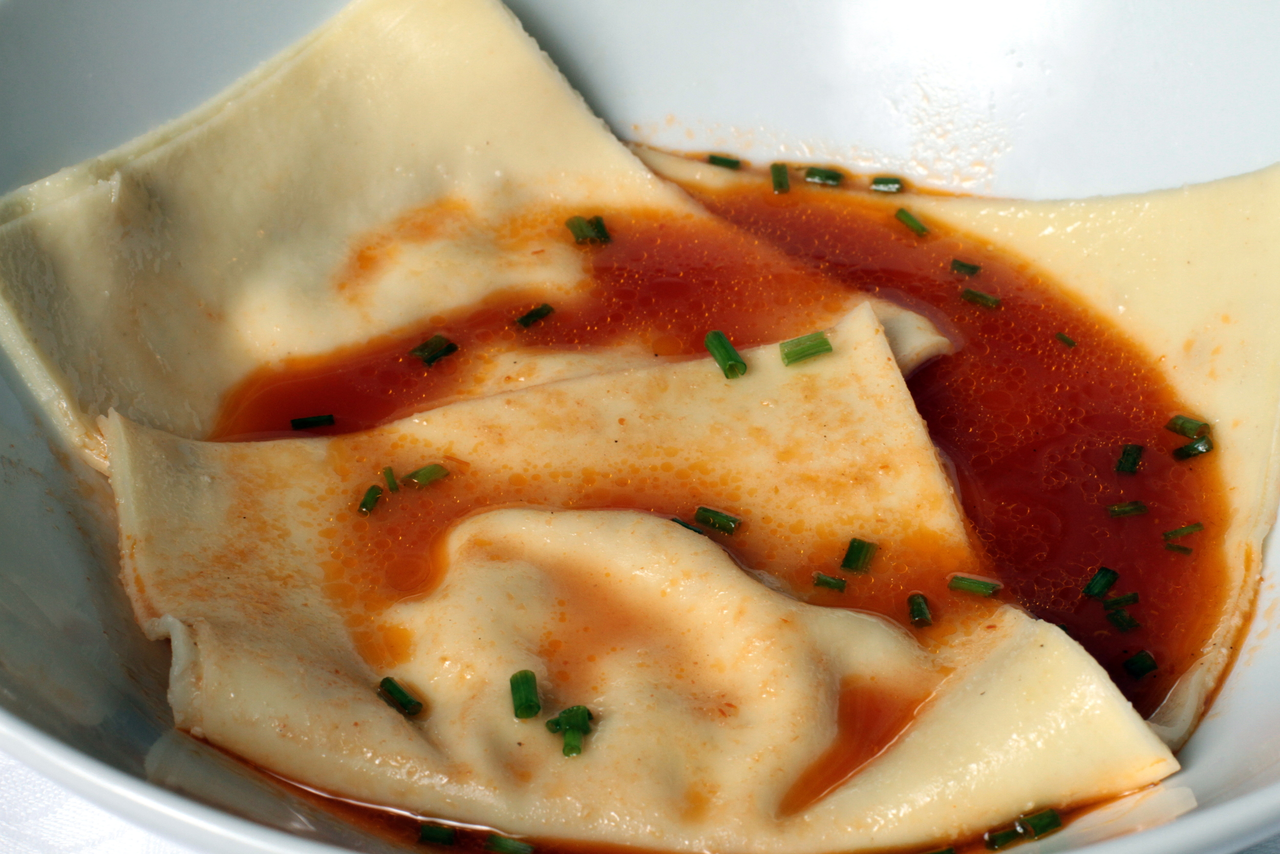lobster ravioli in tomato fennel broth