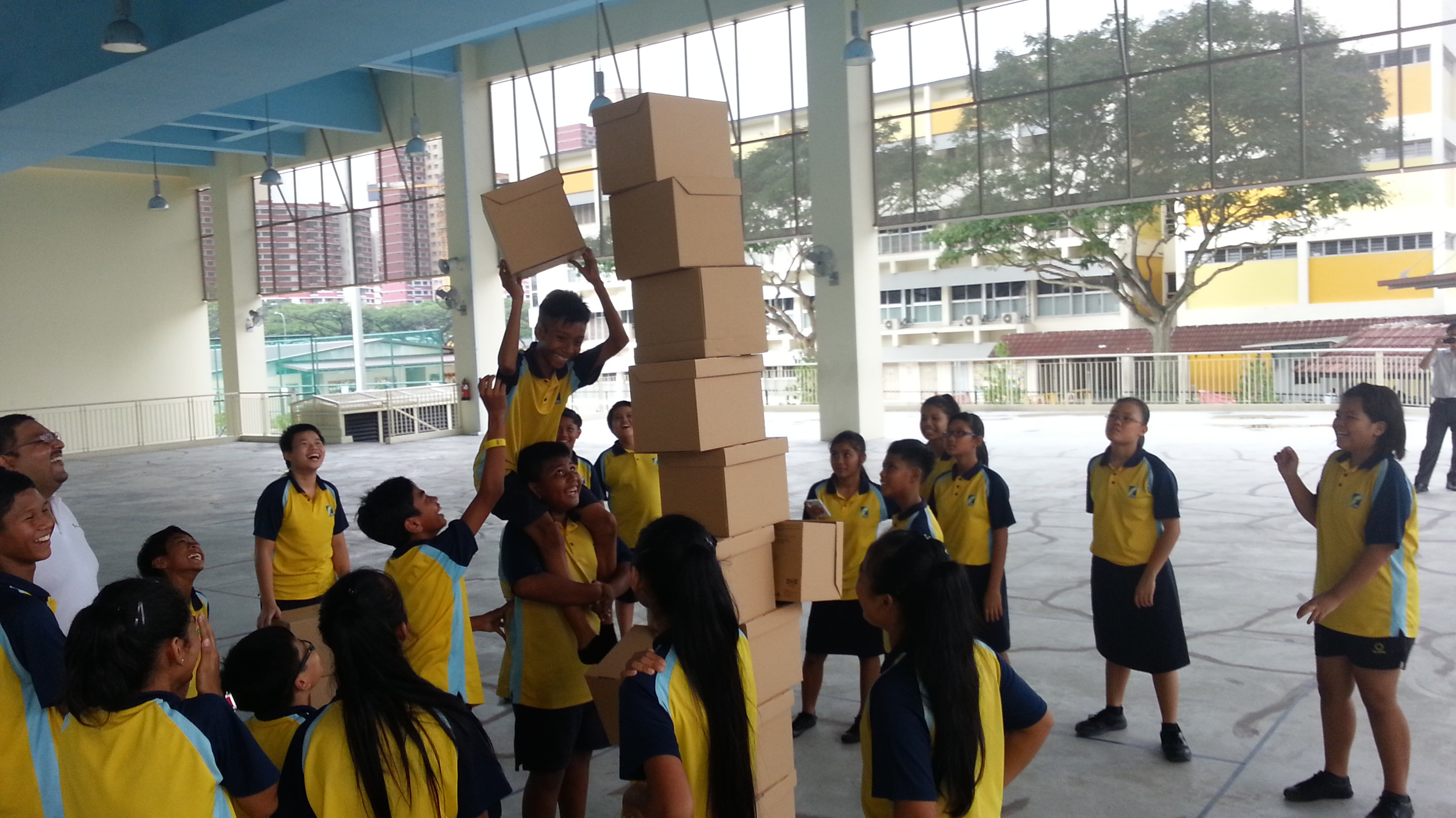 Clifton with students having a blast with boxes.