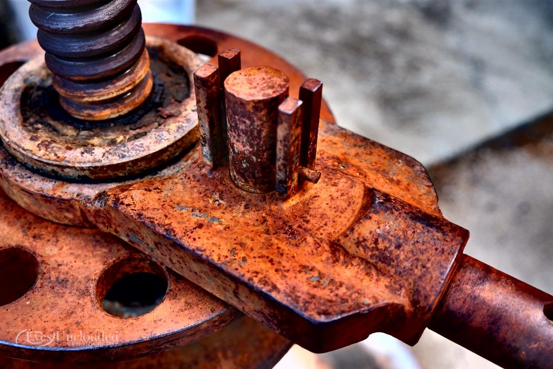 A rusty grape mill