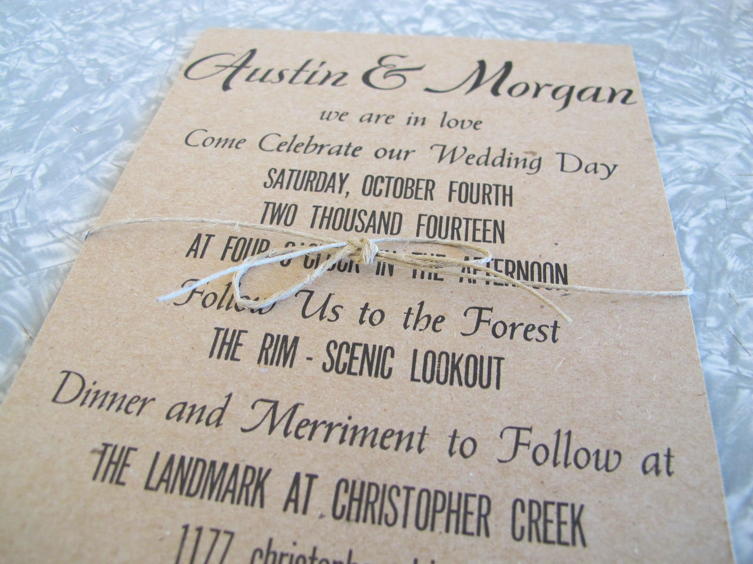 Letterpressed wedding invitation on chipboard.  Wrapped in a simple piece of twine.