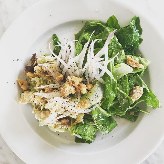 Chicken salad over arugula with preserved lemon aioli, bing cherries, shaved torpedo onions, candied walnuts & tarragon mustard vinaigrette.  #winebar #ojai