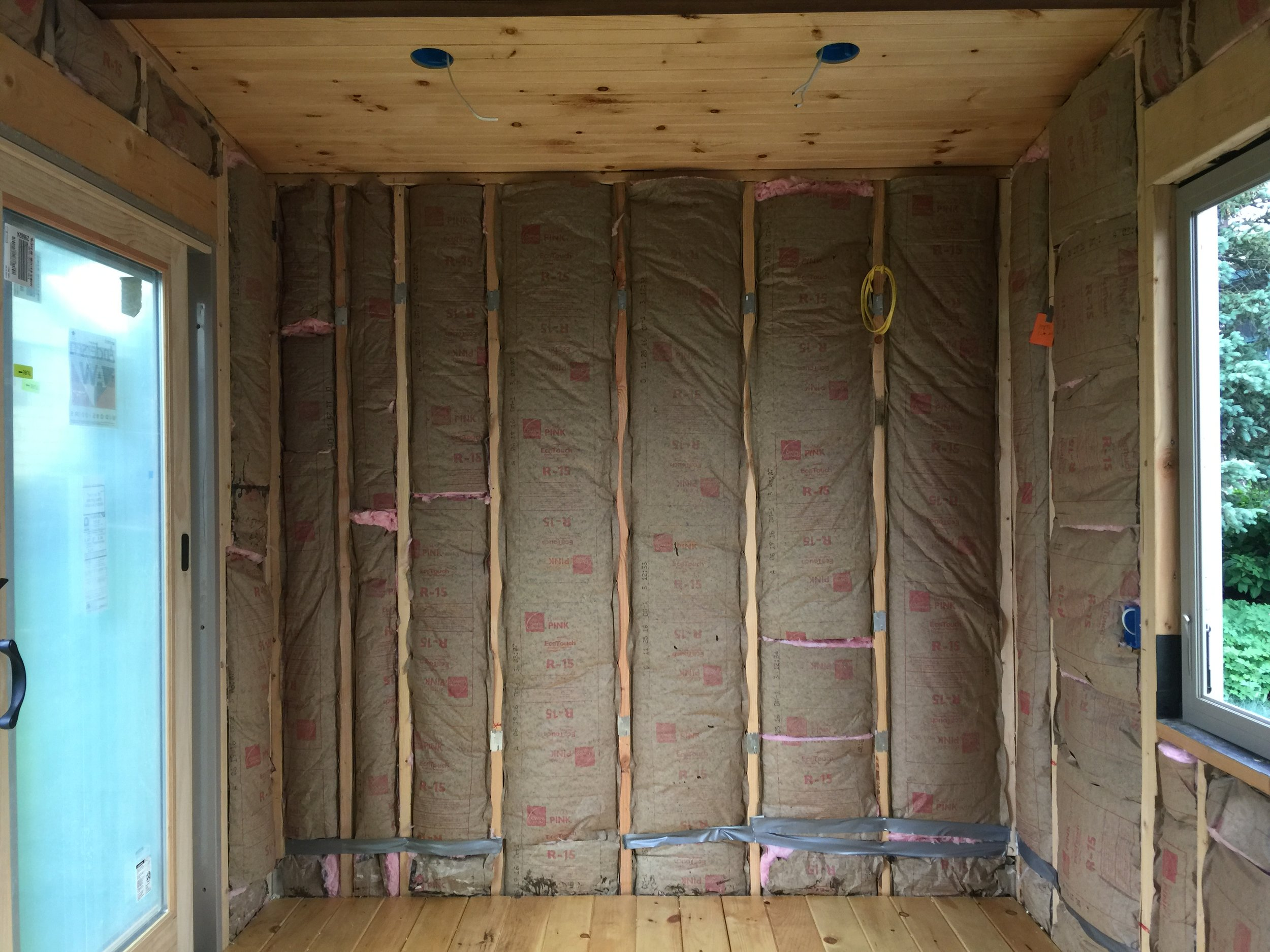 In order to be able to do finish insulation, things needed to be thought out, such as nailers for eventual shelving, supports for wall cabinets, bracing for the stairs to be attached to. With a few of those things still remaining to be done, we're almost ready to install the wall board in areas that won't be affected by plumbing installation. Note that were wires run through studs, although we run them back as far as possible on the stud, for future safety reasons, i put metal plates on the stud edge to prevent accidentally damaging the wires.