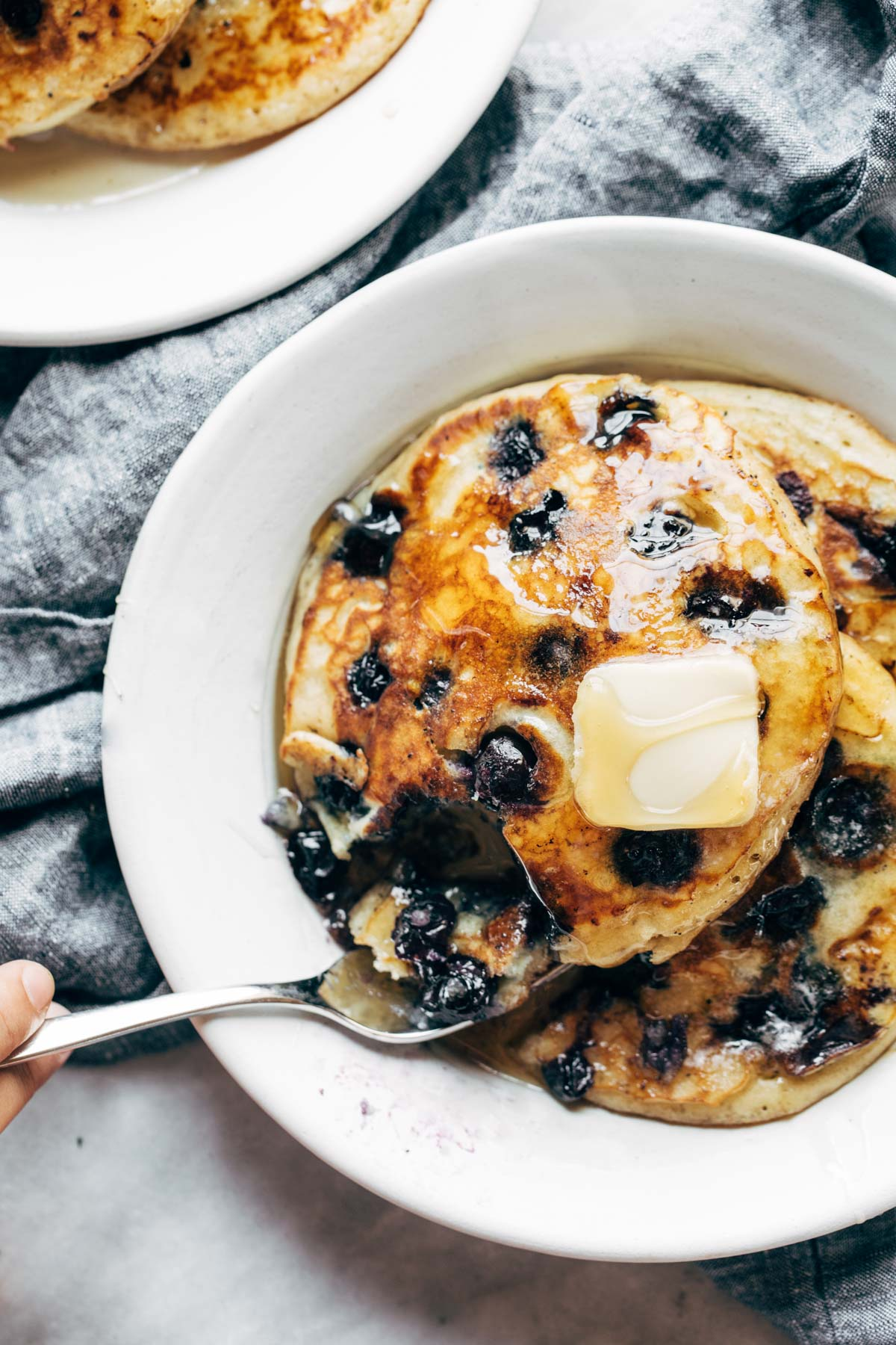 Taking-a-Bite-of-Blueberry-Pancakes.jpg