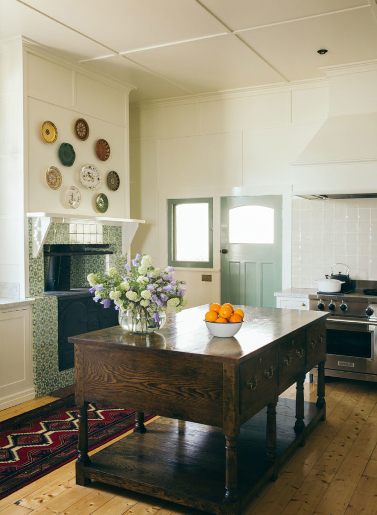 kitchen-wood-island-hanging-plates-antique-rug-runner-wood-floors-sorrento-beach-house-anna-spiro-interior-design-751x1024.jpg