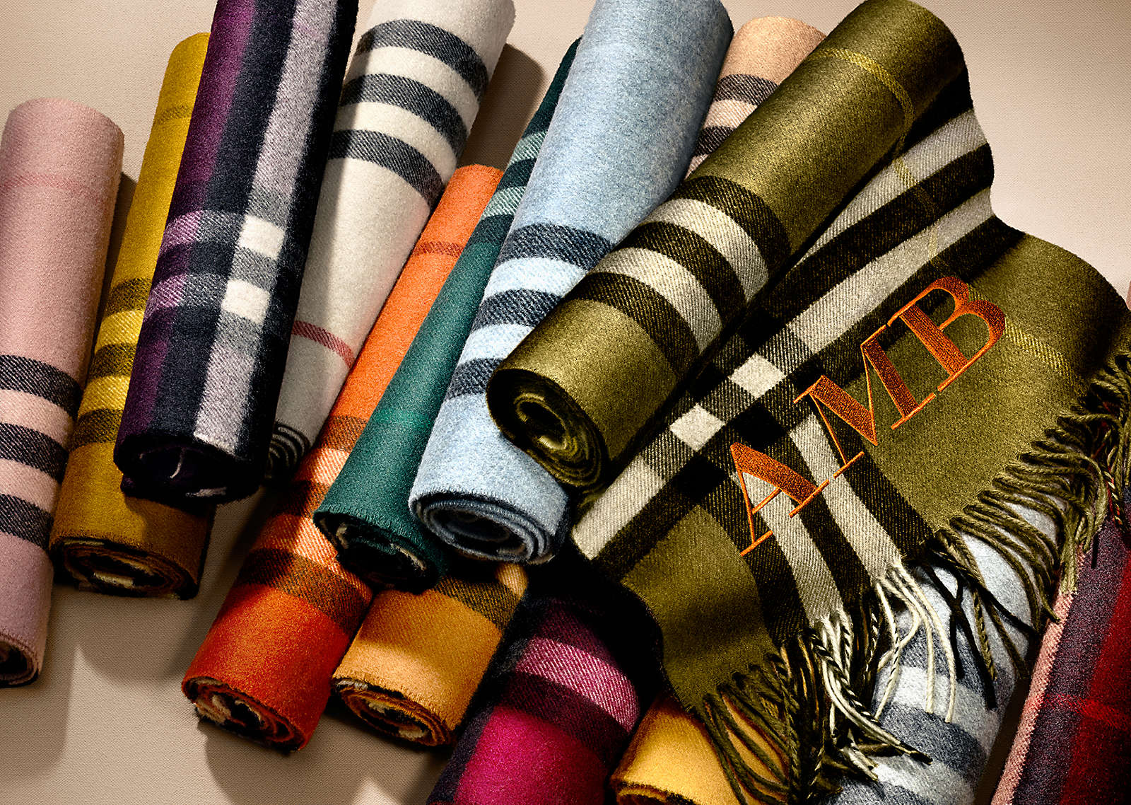 Burberry now offers customers the option to customize their scarves with their initials.  source: Burberry.com
