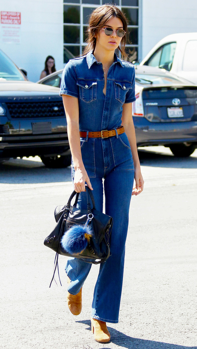 Kendall Jenner with one of her many Fendi Fur Pom bag charm she owns.