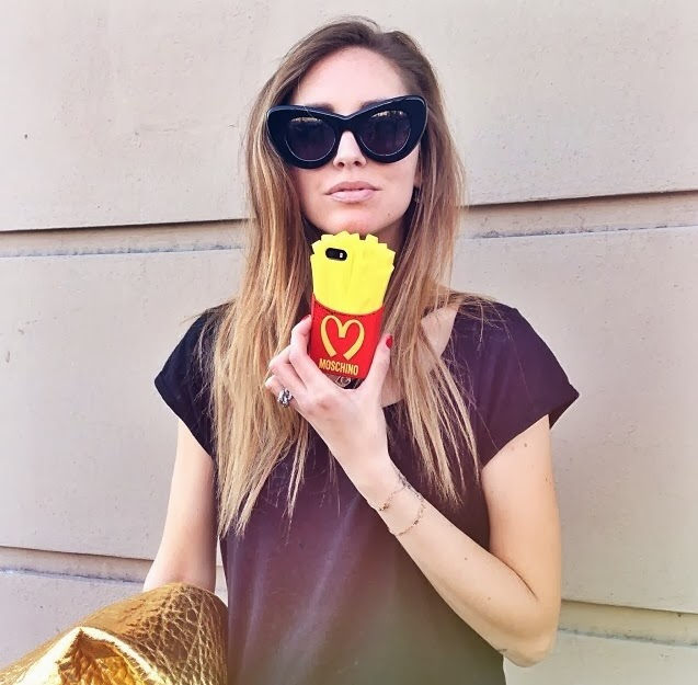 Chiarra Ferragni showing off her Moschino iPhone case. Are you going to eat that though? Because I can buy you real fries for A LOT cheaper.
