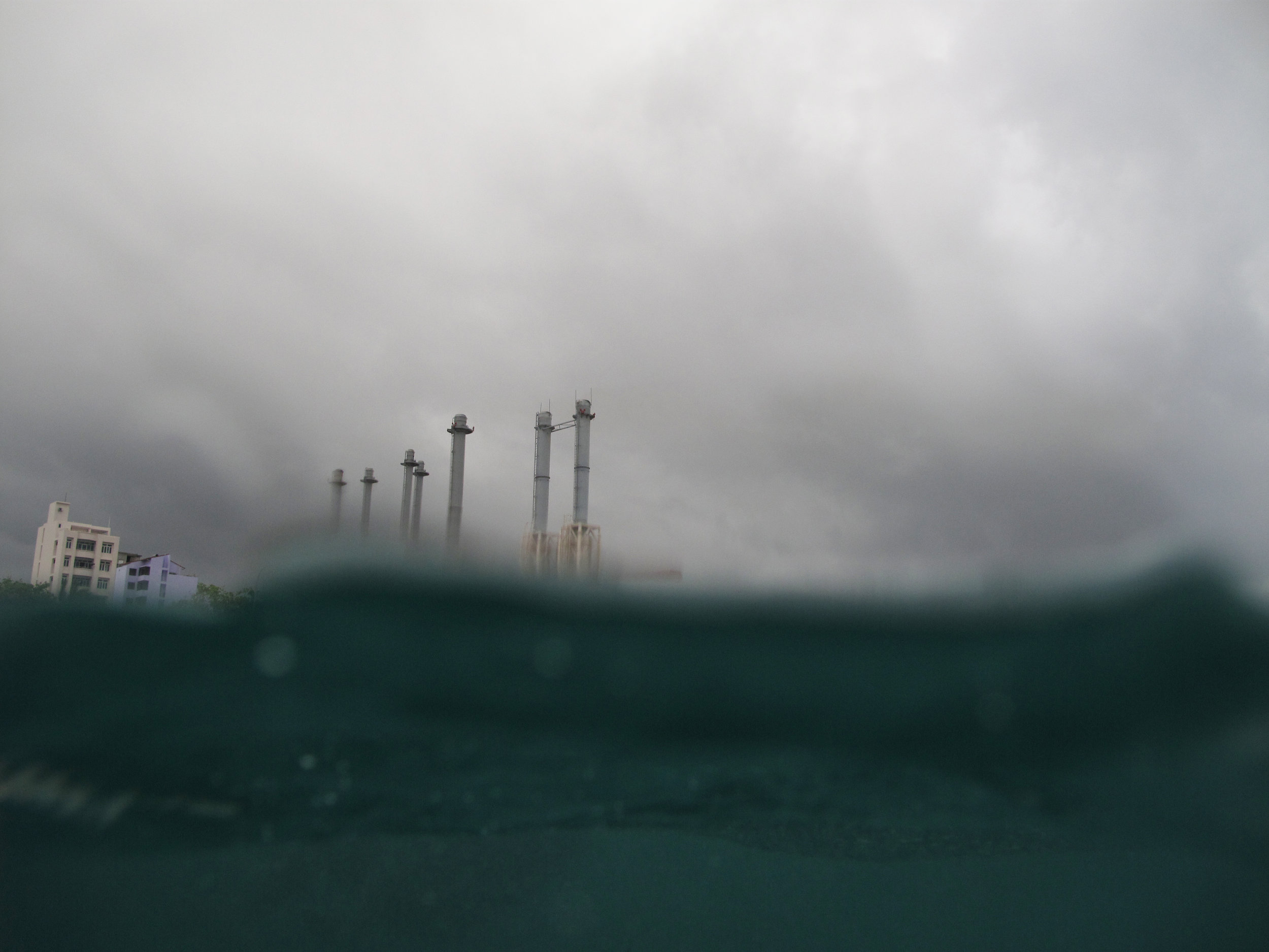 The STELCO towers from the water on a stormy day. Canon PowerShot G10  (2009)