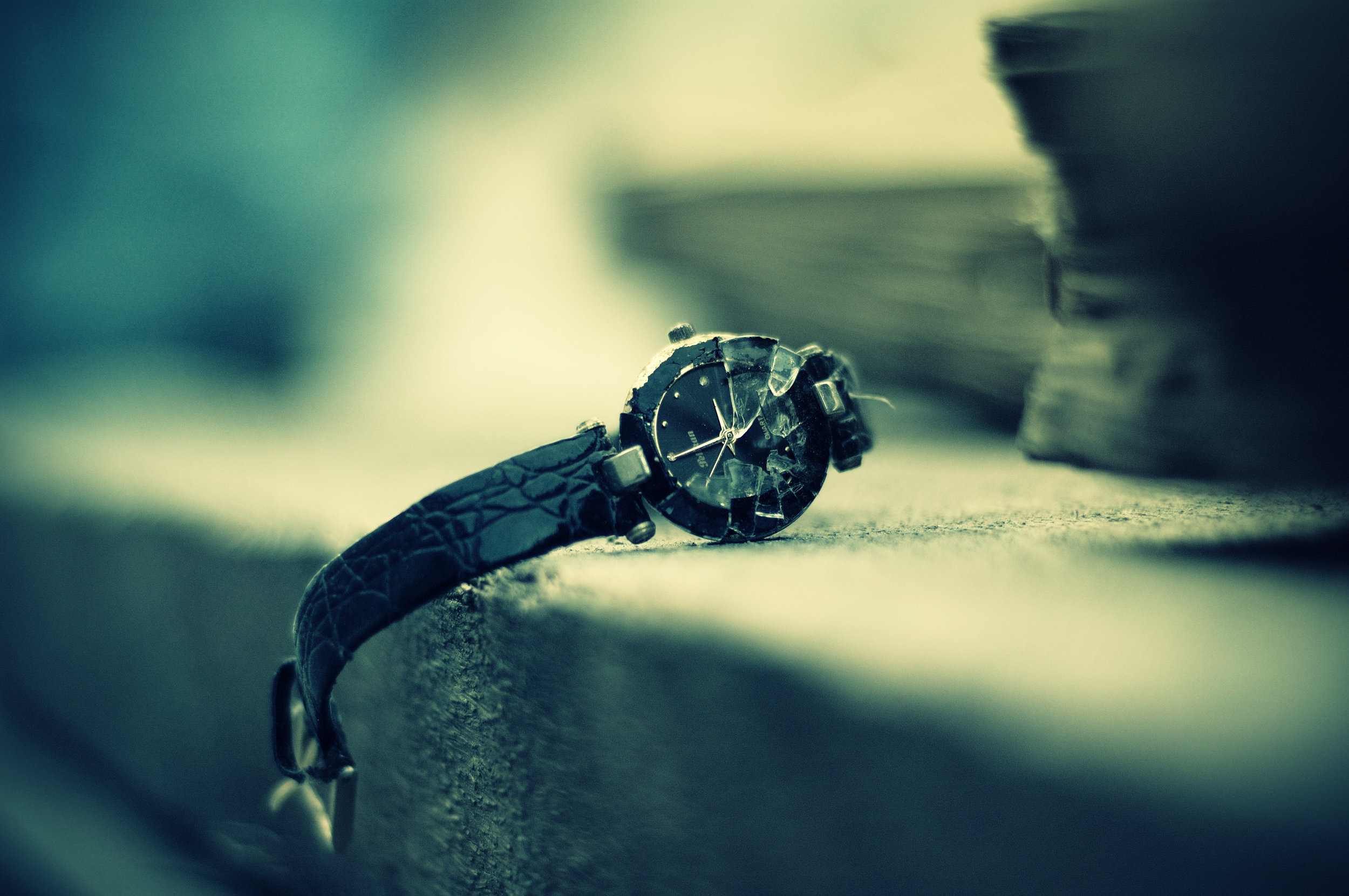 Broken watch that I found sitting on the side of a pull cart. Male' City, Maldives. Nikon D70s. (2008)