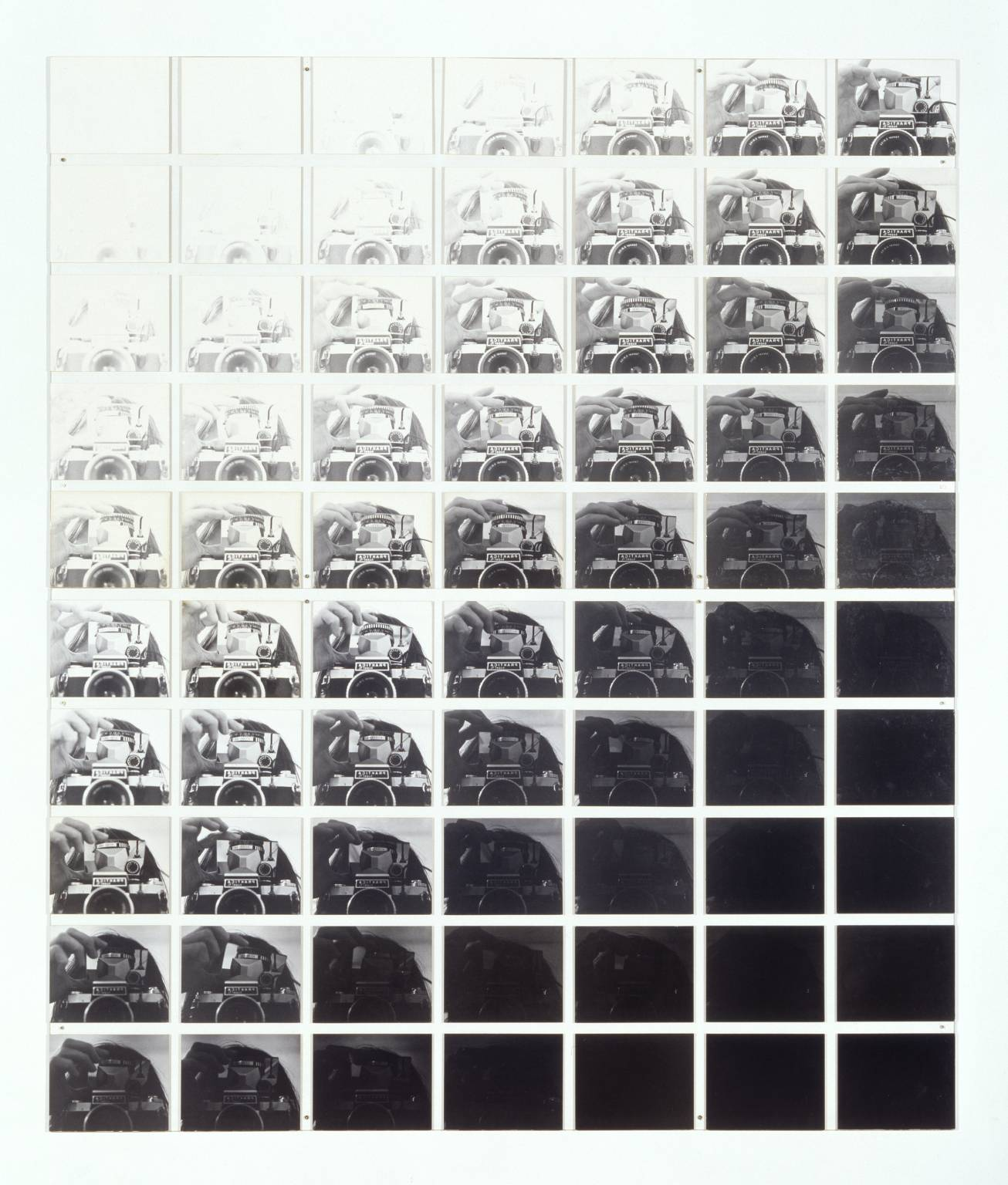 Fig. 1.  Camera Recording its Own Condition (7 Apertures, 10 Speeds, 2 Mirrors)  (1971)