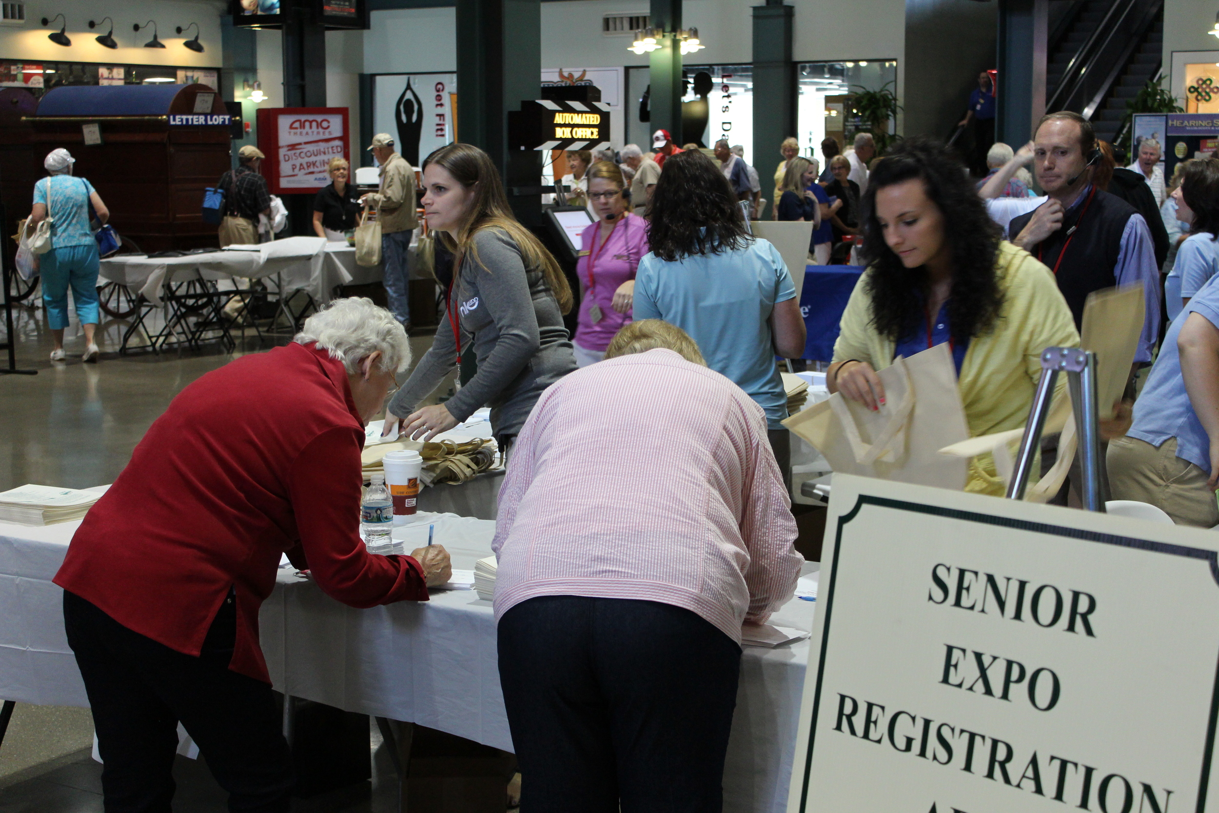 Each year the NKADD organizes the Senior Expo to bring resources to the senior population of Northern Kentucky.  NKADD Case Manager Jeri Riley volunteered her time at the 2013 Senior Expo to register participants.  This year's event was the biggest in its history with over 1,600 attendees.  Photo credit: NKADD