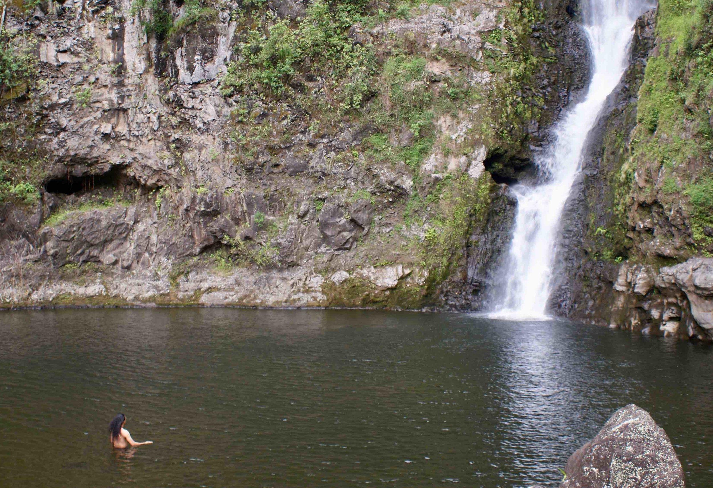 Kumu Kawika Foster at Moʻoula falls halawa molokai.jpg