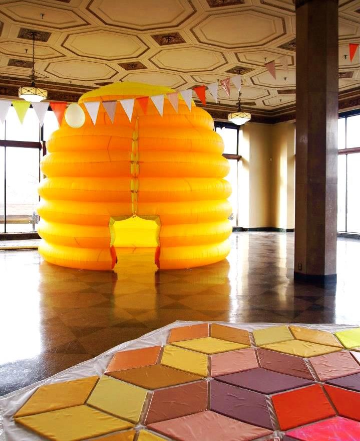 Festooning the Inflatable Beehive at the show System:ECOnomies at Boston University's 808 Gallery.