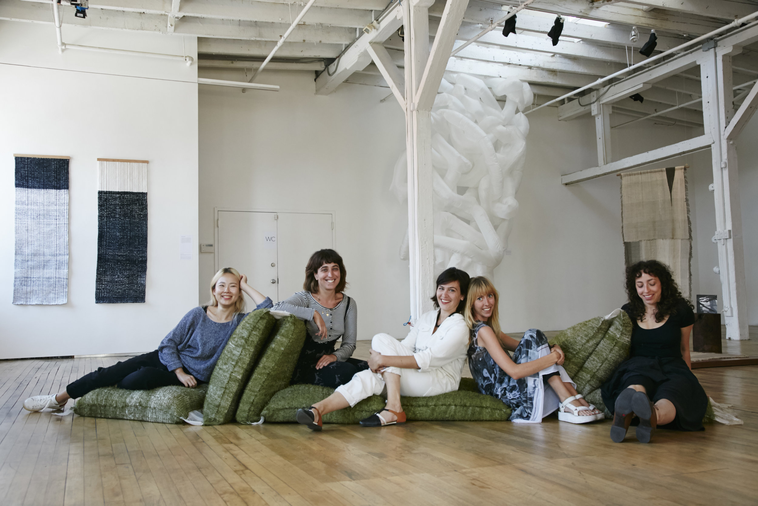 Photo by Kate Reeder at FRAY at Gowanus Loft, BK.Folded Land is sat on by fellow artists and director of the artists residence program at the  Textile Arts Center .