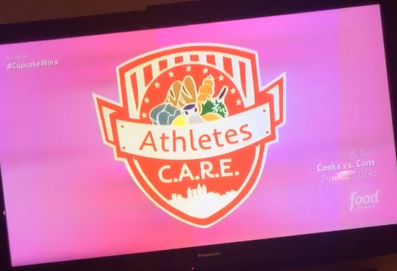 The Athletes C.A.R.E. logo being shown during Cupcake Wars