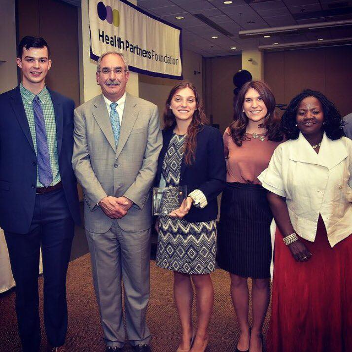 Members of Athletes C.A.R.E. Accepting the Health Partners Foundation Community Transformation Award