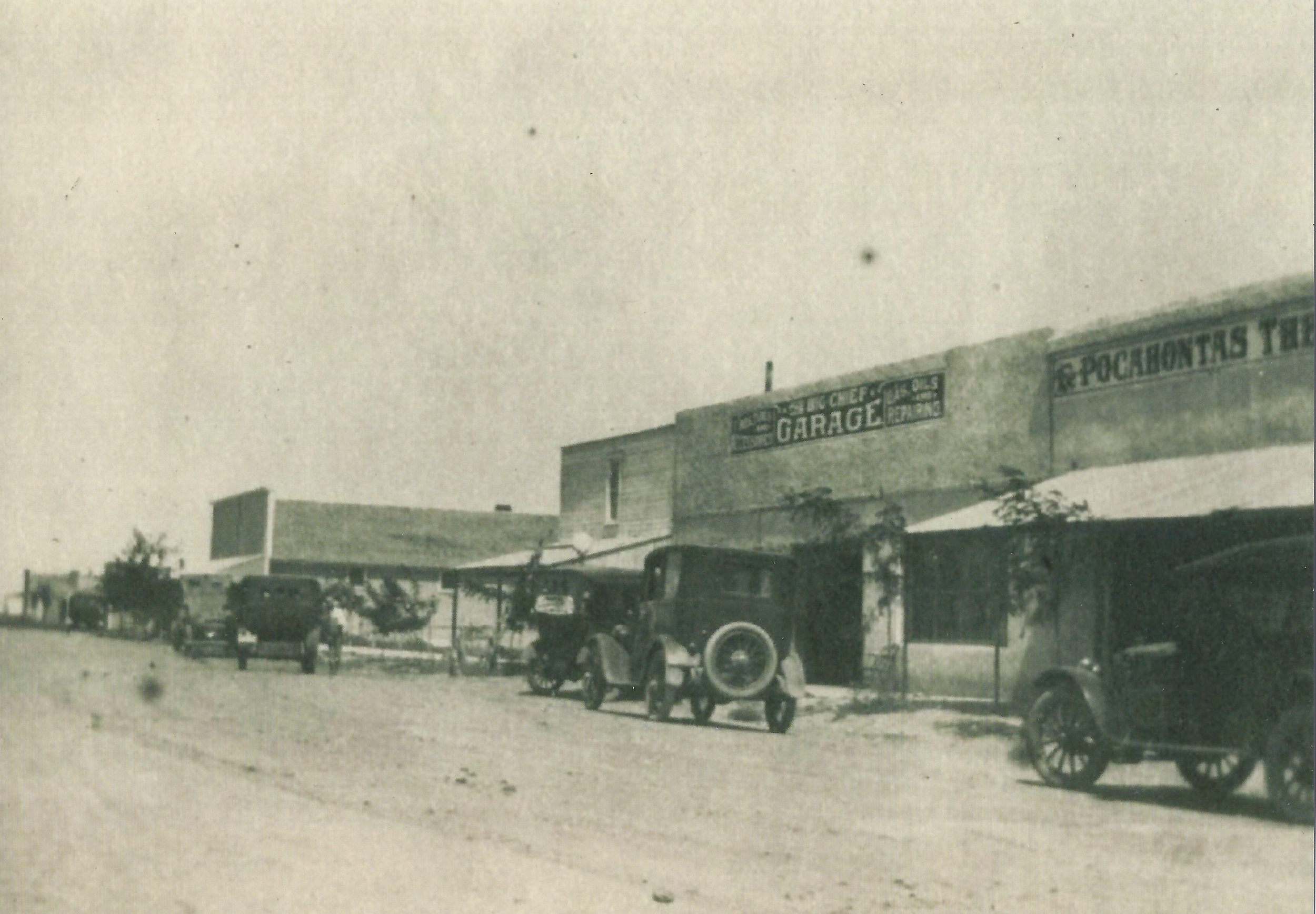 The Big Chief Garage and The Pocahontas Theatre on main street in Satanta, Kansas.