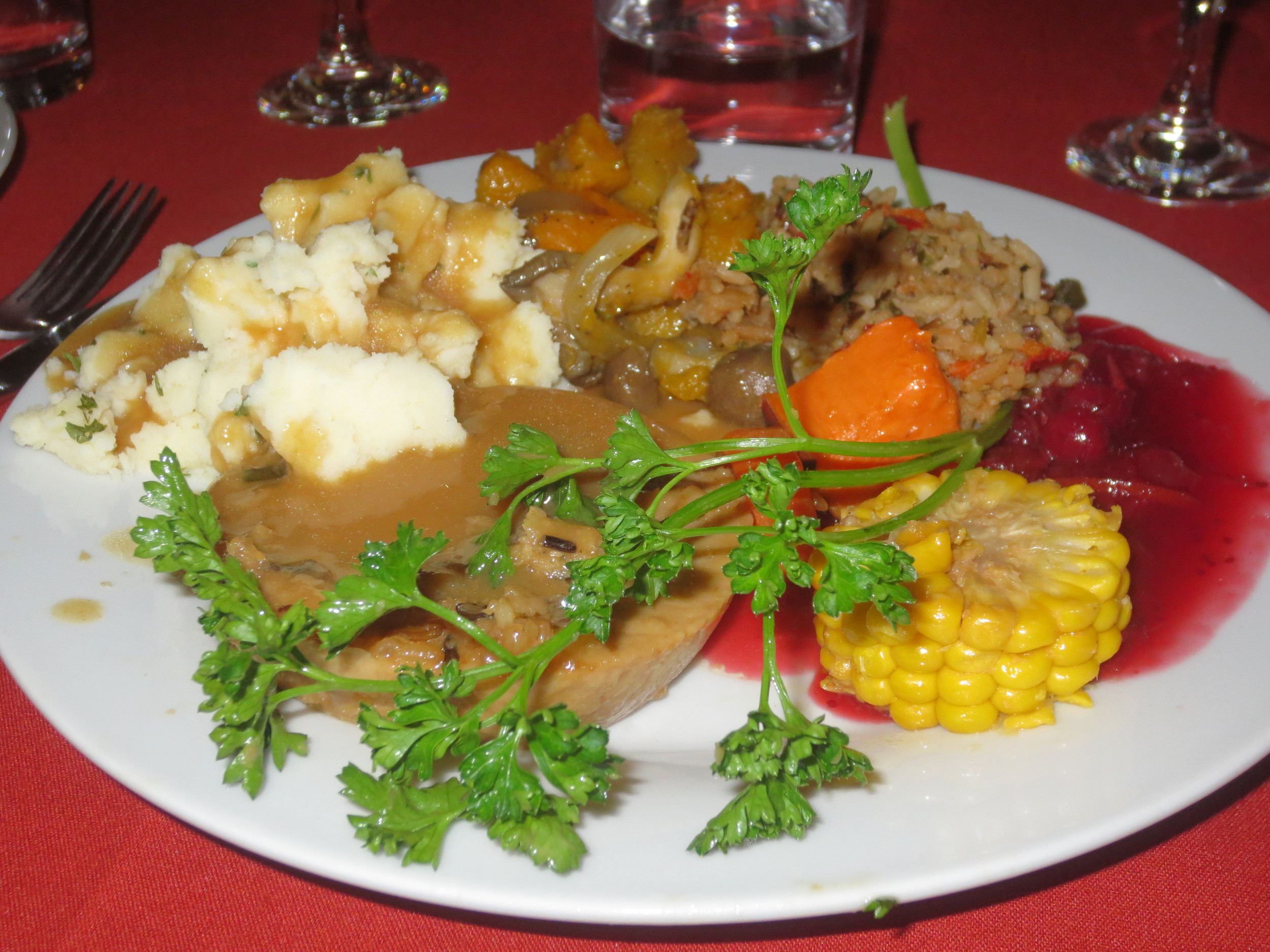 The vegan dinner featured Tofurky Roast filled with a Wild Rice and Whole Wheat Bread Crumb Stuffing, Garlic Mashed Potatoes, Rice Pilaf with Caramelized Onions, Sauteed Butternut Squash with Wild Mushrooms, Orange-Cranberry Compote, and Savory Gravy.